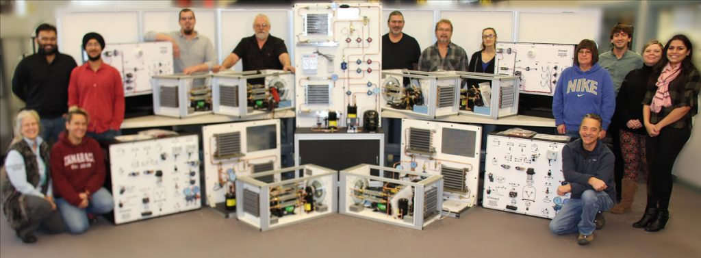 Team at iConnect Training displays their HVAC training units